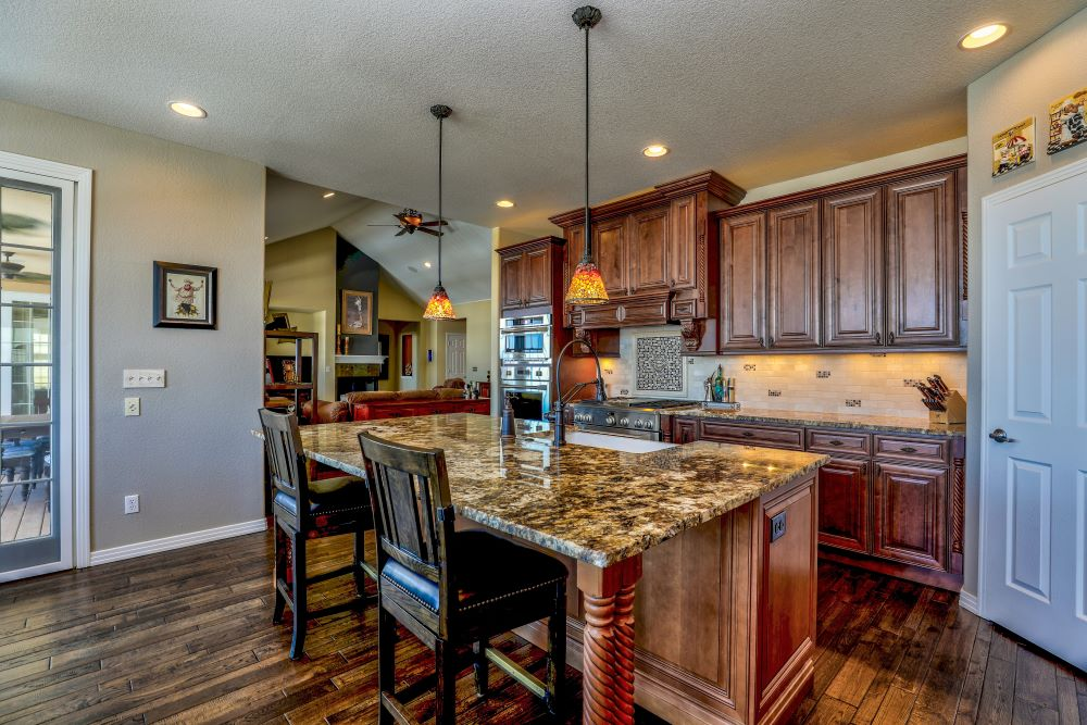 earth tone kitchen design with a large center island