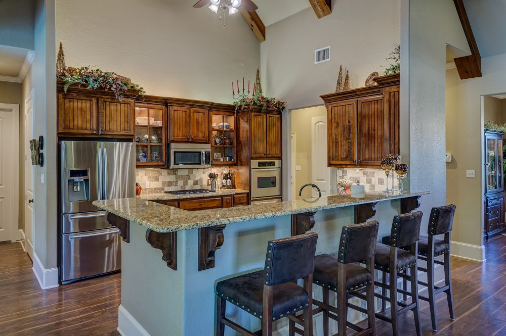 open kitchen design with vaulted ceilings and natural wood beams