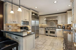 the inside of a beautiful modern kitchen with low ceiling lighting