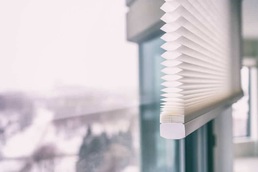a closeup of cellular shades blinds in a kitchen